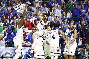 The Kansas bench goes wild after a late three by reserve guard Tyler Self with seconds remaining in the Jayhawks' 100-62 win over UC Davis on Friday, March 17, 2017 at BOK Center in Tulsa, Oklahoma.