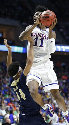 Kansas guard Josh Jackson (11) elevates for a shot over UC Davis forward Garrison Goode (44) during the second half on Friday, March 17, 2017 at BOK Center in Tulsa, Oklahoma.