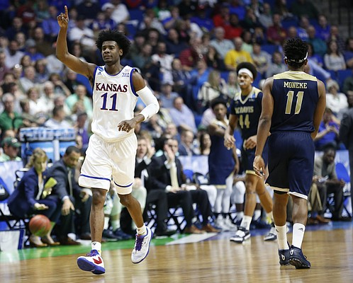 Kansas guard Josh Jackson (11) signals the ball going the Jayhawks' way after a UC Davis turnover during the second half on Friday, March 17, 2017 at BOK Center in Tulsa, Oklahoma.