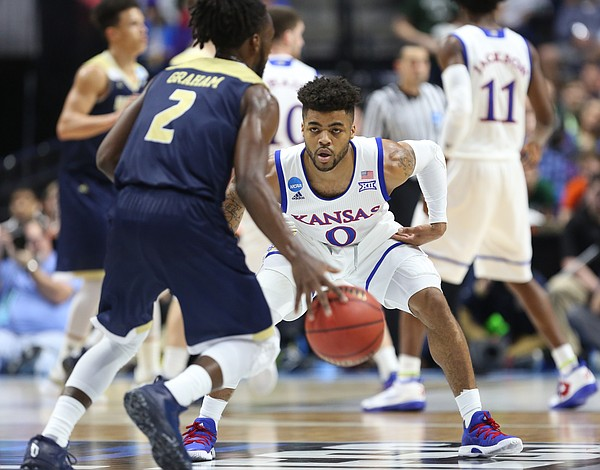 Kansas guard Frank Mason III (0) gets down on defense as UC Davis guard Darius Graham (2) brings the ball up the court during the second half on Friday, March 17, 2017 at BOK Center in Tulsa, Oklahoma.