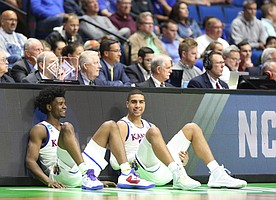 Kansas guard Josh Jackson, left, and Kansas forward Landen Lucas have a laugh while waiting to check in during the second half on Friday, March 17, 2017 at BOK Center in Tulsa, Oklahoma.