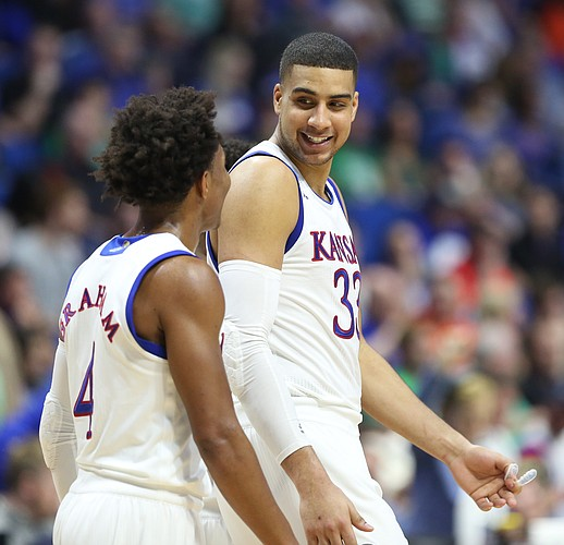 Kansas forward Landen Lucas (33) and Kansas guard Devonte' Graham (4) keep it loose during the second half on Friday, March 17, 2017 at BOK Center in Tulsa, Oklahoma.