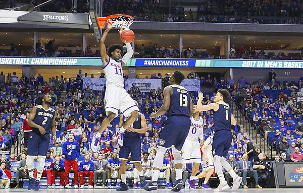 Kansas guard Josh Jackson (11) delivers a dunk during the second half on Friday, March 17, 2017 at BOK Center in Tulsa, Oklahoma.
