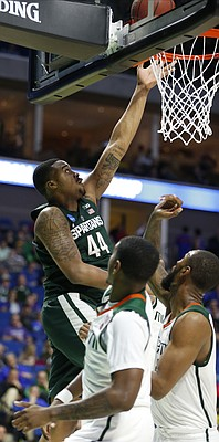 Michigan State forward Nick Ward (44) gets a bucket against Miami during the second half on Friday, March 17, 2017 at BOK Center in Tulsa, Oklahoma.