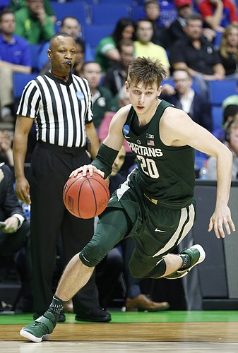 Michigan State guard Matt McQuaid (20) drives to th bucket during the second half on Friday, March 17, 2017 at BOK Center in Tulsa, Oklahoma.