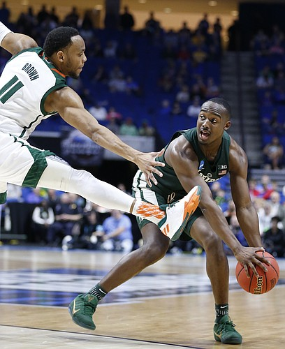 Michigan State guard Joshua Langford (1) looks to throw  pass around Miami guard Bruce Brown (11) during the second half on Friday, March 17, 2017 at BOK Center in Tulsa, Oklahoma.