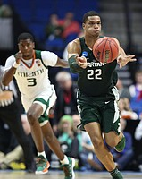 Michigan State guard Miles Bridges (22) pushes the ball up the court during the second half on Friday, March 17, 2017 at BOK Center in Tulsa, Oklahoma.