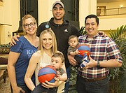 Landen Lucas is pictured with his mother Shelley Lucas, Meredith and Ian Sadler of Tulsa, and their twin, ten-month-old boys, Landon and Lucas Sadler, who were named after the Kansas forward. The group is pictured on Saturday, March 18, 2017 at the Renaissance Hotel in Tulsa, Okla.