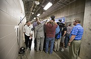 Michigan State head coach Tom Izzo squeezes past a gathering of media members as they interview Kansas head coach Bill Self outside the Kansas locker room on Saturday, March 18, 2017 at BOK Center in Tulsa, Okla.