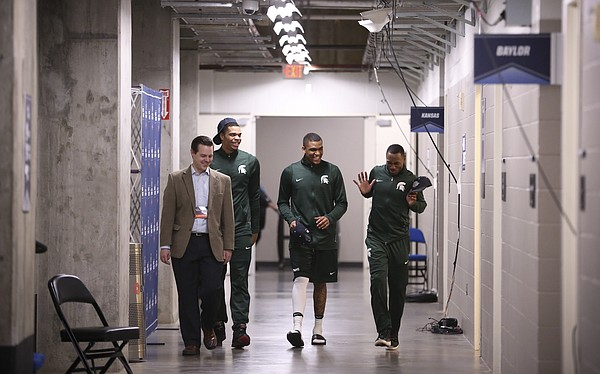 Michigan State guards Miles Bridges, second from left, Alvin Ellis III and Lourawls Nairn Jr. are escorted to interviews on Saturday, March 18, 2017 at BOK Center in Tulsa, Okla.