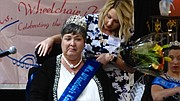 Amy Holovach, Ms. Wheelchair Kansas Steering Committee member, adjusts a sash on Deborah Young, of Lawrence, after she was named the 14th Ms. Wheelchair Kansas at a pageant Sunday, March 19, 2017 at the DoubleTree Hotel. The pageant is held annually to select an articulate woman and role model to advocate, educate and empower people on all levels. Young, a career educator who now volunteers in Lawrence schools, lost both legs and her left arm in a 2013 car accident.