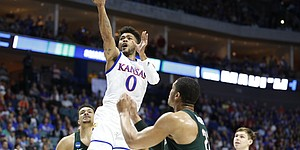 Kansas guard Frank Mason III (0) gets in for a bucket against Michigan State during the first half on Sunday, March 19, 2017 at BOK Center in Tulsa, Okla.