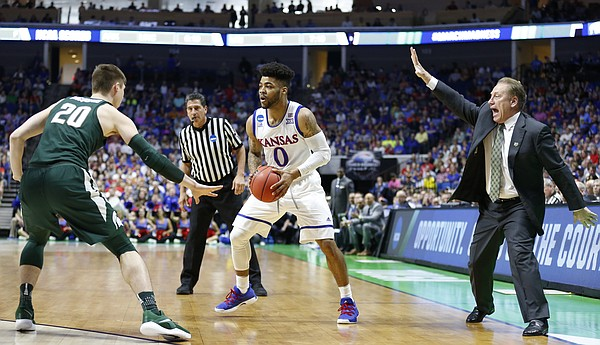 Michigan State head coach Tom Izzo directs his defense as Michigan State guard Matt McQuaid (20) guards Kansas guard Frank Mason III (0) during the first half on Sunday, March 19, 2017 at BOK Center in Tulsa, Okla.