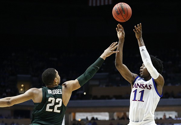 Kansas guard Josh Jackson (11) puts a shot over Michigan State guard Miles Bridges (22) during the first half on Sunday, March 19, 2017 at BOK Center in Tulsa, Okla.