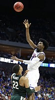 Kansas guard Josh Jackson (11) lofts a shot over Michigan State guard Miles Bridges (22) during the first half on Sunday, March 19, 2017 at BOK Center in Tulsa, Okla.