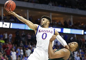 Kansas guard Frank Mason III (0) extends to the bucket past Michigan State forward Nick Ward (44) during the first half on Sunday, March 19, 2017 at BOK Center in Tulsa, Okla.