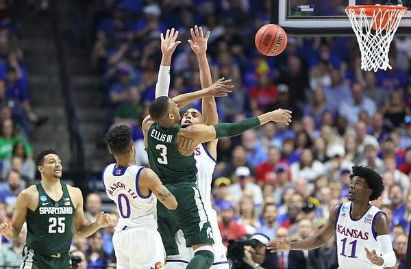 Michigan State guard Alvin Ellis III (3) loses the ball while defended by Kansas forward Landen Lucas (33) during the first half on Sunday, March 19, 2017 at BOK Center in Tulsa, Okla.