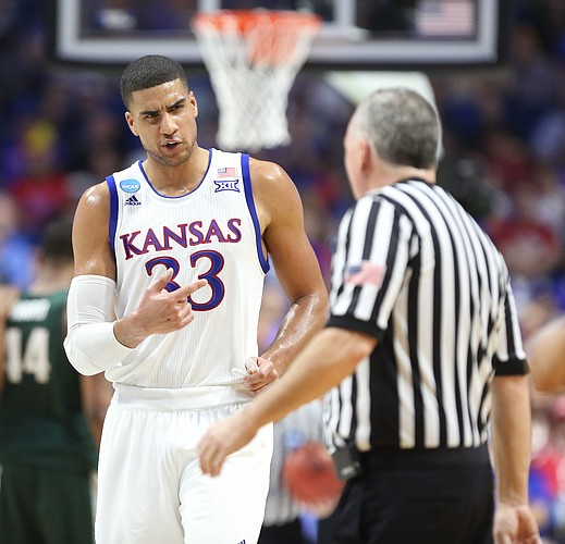 Kansas forward Landen Lucas (33) questions a blocking foul called on Kansas guard Josh Jackson during the first half on Sunday, March 19, 2017 at BOK Center in Tulsa, Okla.