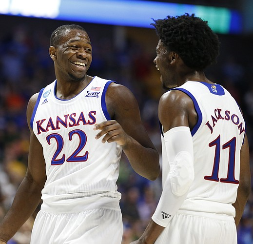 Kansas forward Dwight Coleby (22) and Kansas guard Josh Jackson (11) have a laugh after a bucket by Coleby and a Michigan State foul during the second half on Sunday, March 19, 2017 at BOK Center in Tulsa, Okla.