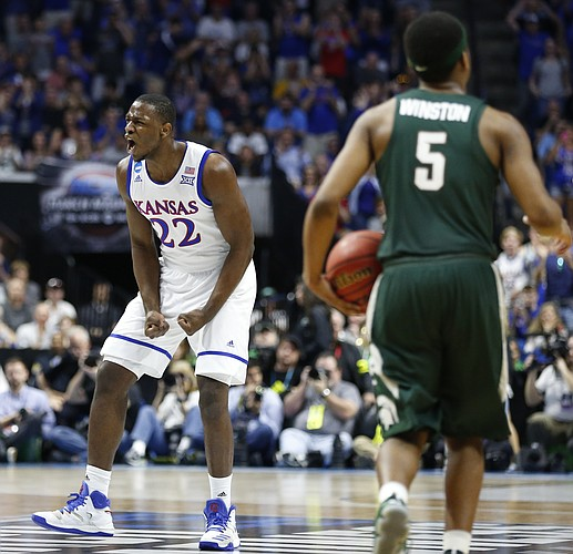 Kansas forward Dwight Coleby (22) celebrates during a Jayhawk run in the second half against Michigan State on Sunday, March 19, 2017 at BOK Center in Tulsa, Okla.