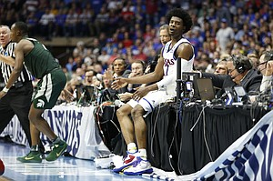 Kansas guard Josh Jackson (11) protests a foul called against him after he thought he was pushed into the scorers table during the second half on Sunday, March 19, 2017 at BOK Center in Tulsa, Okla.