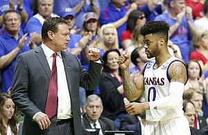 Kansas head coach Bill Self and Kansas guard Frank Mason III (0) pound fists as Mason leaves the game late in the second half on Sunday, March 19, 2017 at BOK Center in Tulsa, Okla.