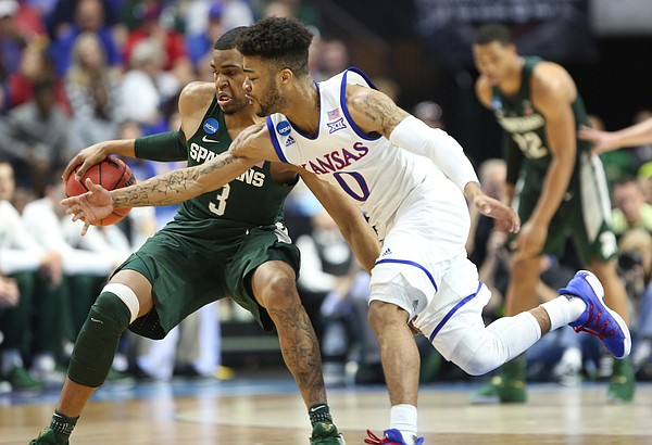 Kansas guard Frank Mason III (0) nearly gets a steal from Michigan State guard Alvin Ellis III (3) during the second half on Sunday, March 19, 2017 at BOK Center in Tulsa, Okla.