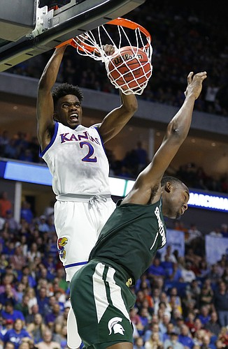 Kansas guard Lagerald Vick (2) delivers a dunk over Michigan State guard Joshua Langford (1) during the second half on Sunday, March 19, 2017 at BOK Center in Tulsa, Okla.