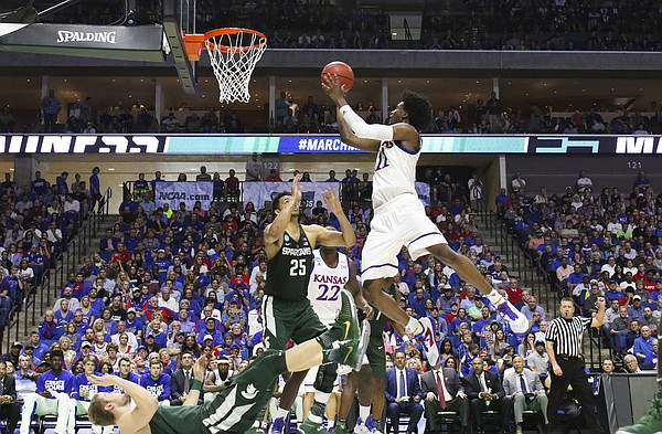 Kansas guard Josh Jackson (11) floats in for a bucket over Michigan State forward Kenny Goins (25) during the second half on Sunday, March 19, 2017 at BOK Center in Tulsa, Okla.