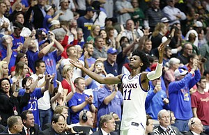 Kansas guard Josh Jackson (11) raises up his arms as he leaves the court with little time remaining during the Jayhawks' 90-70 win over Michigan State on Sunday, March 19, 2017 at BOK Center in Tulsa, Okla.