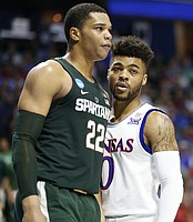 Michigan State forward Miles Bridges (22) and Kansas guard Frank Mason III (0) get up close after a drive by Mason during the first half on Sunday, March 19, 2017 at BOK Center in Tulsa, Okla.