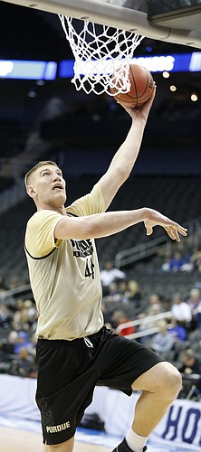 Purdue center Isaac Haas (44) hooks in a shot during a day of practices and press conferences prior to Thursday's game at Sprint Center in Kansas City, Mo.