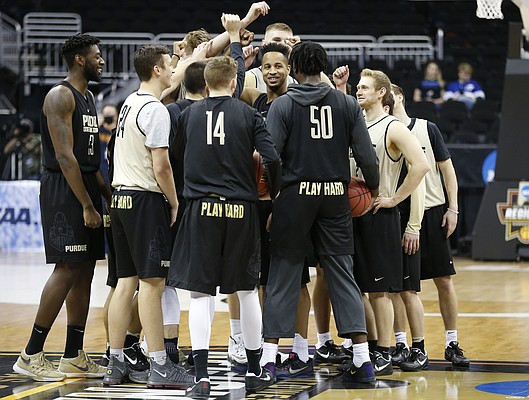 The Purdue Boilermakers come together at half court after a practice on Wednesday prior to Thursday's game at Sprint Center in Kansas City, Mo.