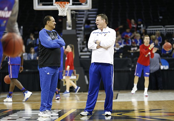 Kansas head coach Bill Self, right, and assistant Kurtis Townsend chat at half court during a day of practices and press conferences prior to Thursday's game at Sprint Center in Kansas City, Mo.