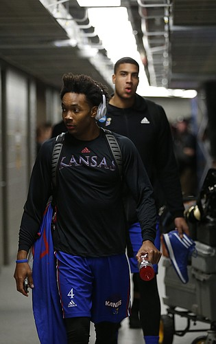 Kansas guard Devonte' Graham (4) is followed by Kansas forward Landen Lucas (33) as the Jayhawks enter Sprint Center during a day of practices and press conferences prior to Thursday's game.