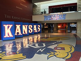Just inside the front doors of Allen Fieldhouse on the University of Kansas campus. The Booth Family Hall of Athletics is home to KU's national championship trophies, the KU Athletics Hall of Fame and other exhibits.