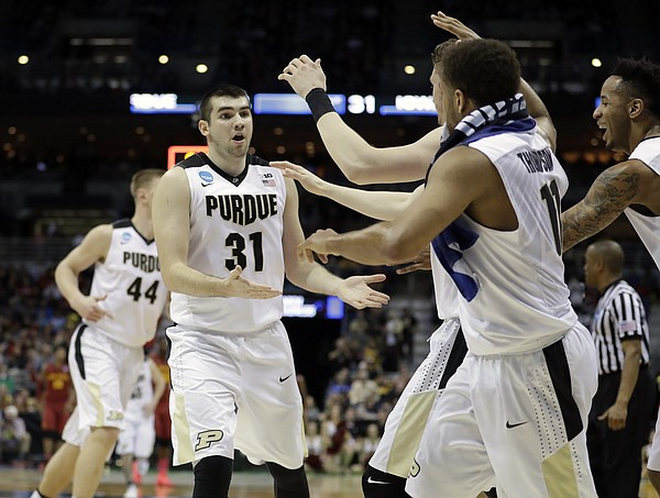 Purdue's Dakota Mathias (31) celebrates with his teammates during the first half of an NCAA college basketball tournament second-round game against Iowa State Saturday, March 18, 2017, in Milwaukee.