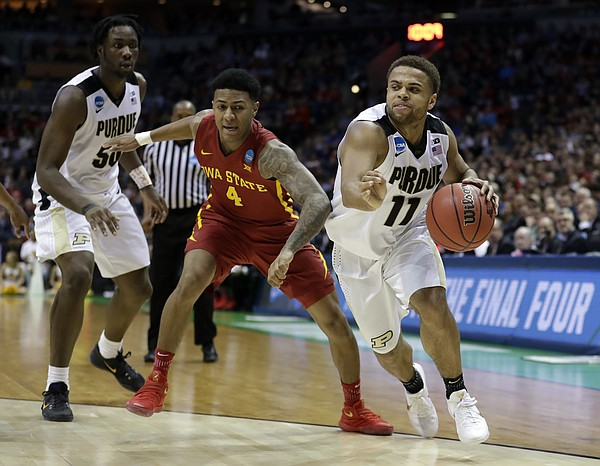 Purdue's P.J. Thompson (11) drives against Iowa State's Donovan Jackson (4) during the second half of an NCAA college basketball tournament second-round game Saturday, March 18, 2017, in Milwaukee.