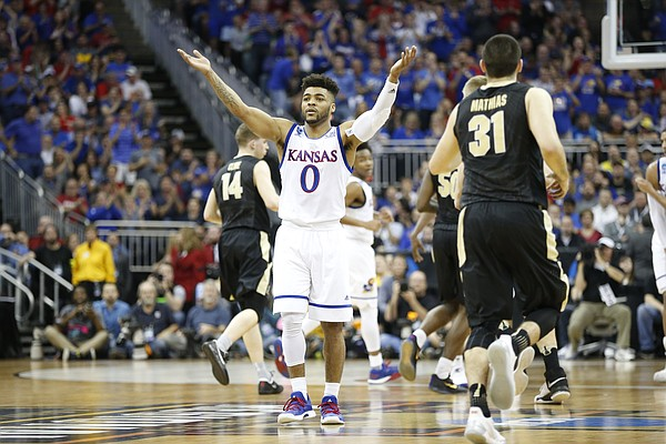 Kansas guard Frank Mason III (0) raises up the Sprint Center crowd during the first half, Thursday, March 23, 2017.
