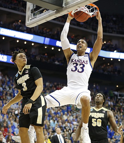 Kansas forward Landen Lucas (33) powers in a dunk against Purdue guard Carsen Edwards (3) and Purdue forward Caleb Swanigan (50) during the second half, Thursday, March 23, 2017 at Sprint Center in Kansas City, Mo.