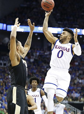 Kansas guard Frank Mason III (0) floats a shot over Purdue forward Vince Edwards (12) during the second half, Thursday, March 23, 2017 at Sprint Center in Kansas City, Mo.