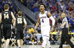 Kansas guard Devonte' Graham (4) celebrates during a Jayhawk run during the second half, Thursday, March 23, 2017 at Sprint Center in Kansas City, Mo., against Purdue.