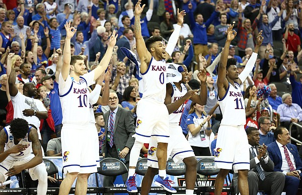 The Kansas bench reacts to a three pointer by Kansas forward Mitch Lightfoot late in the second half, Thursday, March 23, 2017 at Sprint Center in Kansas City, Mo.