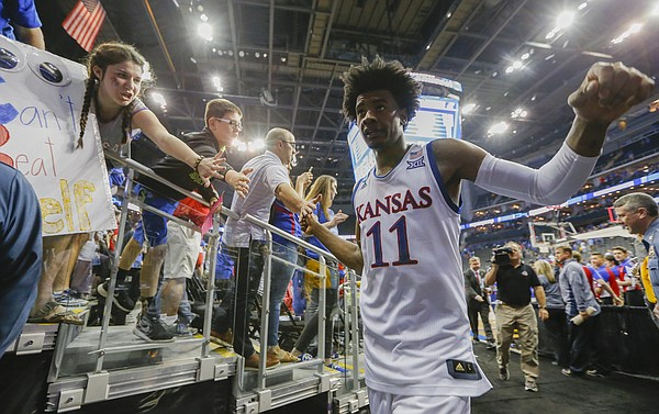 Kansas guard Josh Jackson (11) slaps hands with fans as he leaves the court following the Jayhawks' 98-66 win, Thursday, March 23, 2017 at Sprint Center in Kansas City, Mo.