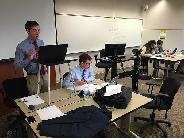 The National Debate Tournament kicked off Friday, March 24, 2017, at the University of Kansas Edwards Campus in Overland Park. Pictured competing in the day's first round of debates is the KU team of Henry Walter (left) and Jacob Hegna, against the Indiana team of Bee Smale (left) and Harry Aaronson. The tournament is expected to run through late Monday night.