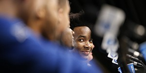 Kansas guard Devonte' Graham (4) smiles as he looks across the dais at his teammates while talking with media members during a press conference on Friday, March 24, 2017 at Sprint Center.