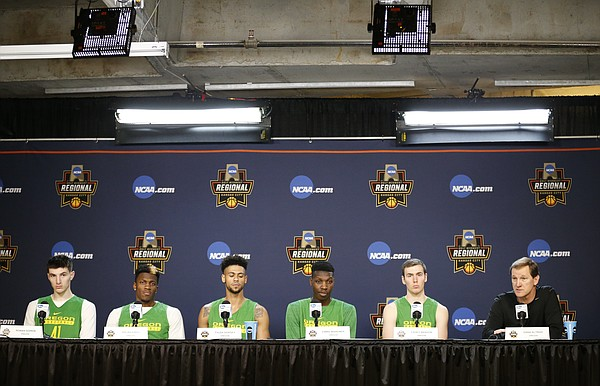 Oregon forward Roman Sorkin, left, guard Dylan Ennis, guard Tyler Dorsey, forward Chris Boucher, guard Casey Benson (2) and head coach Dana Altman talk with media members during a press conference on Friday, March 24, 2017 at Sprint Center.