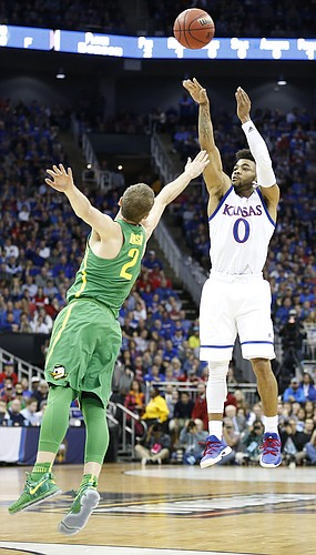 Kansas guard Frank Mason III (0) puts up a three over Oregon guard Casey Benson (2) during the first half on Saturday, March 25, 2017 at Sprint Center.