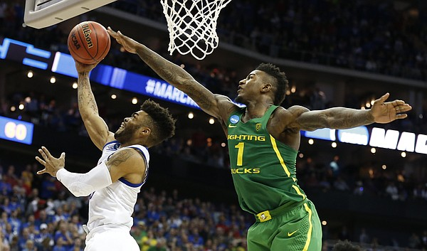 Oregon forward Jordan Bell (1) reaches long to disrupt a shot from Kansas guard Frank Mason III (0) during the second half on Saturday, March 25, 2017 at Sprint Center.