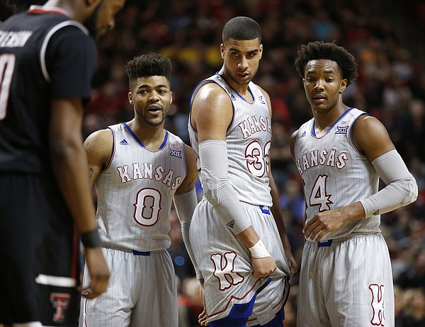 Kansas guard Frank Mason III (0), forward Landen Lucas (33) and guard Devonte' Graham (4) come together during a Texas Tech surge in the second half, Saturday, Feb. 11, 2017 at United Supermarkets Arena in Lubbock, Texas.